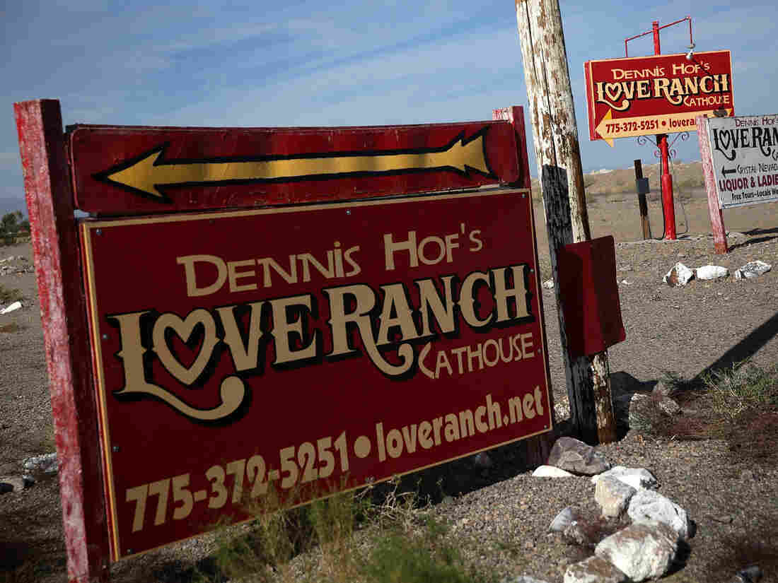CRYSTAL, NV - OCTOBER 14: Signs for Dennis Hof's Love Ranch Las Vegas brothel are shown on October 14, 2015 in Crystal, Nevada.