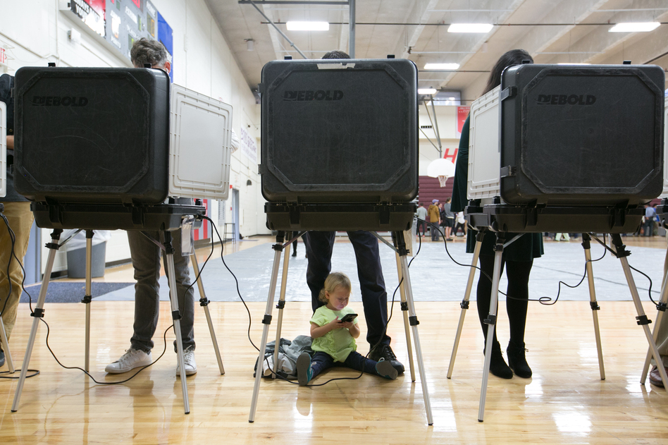 Voters at an Atlanta high school on Election Day 2018. Georgia Gov. Brian Kemp has signed a new law addressing some of the complaints about how that election was run. (Jessica McGowan/Getty Images)
