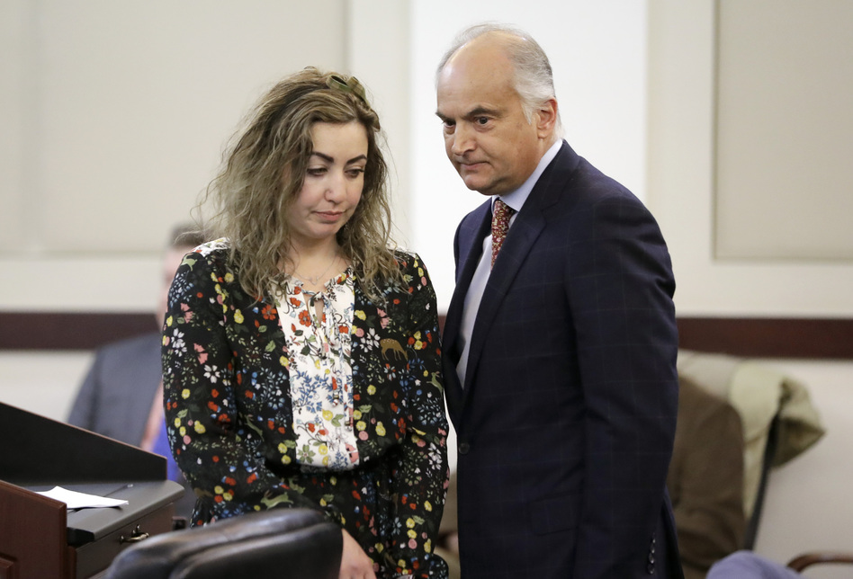 RaDonda Vaught appears at a court hearing with her attorney, Peter Strianse, in February. Vaught, a former nurse at Vanderbilt University Medical Center, was charged with reckless homicide after a medication error killed a patient. (Mark Humphrey/AP)