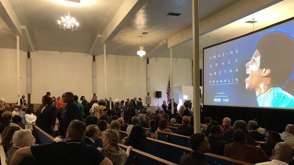 Viewers find their seats inside The New Temple Missionary Baptist Church for the LA screening of Amazing Grace.