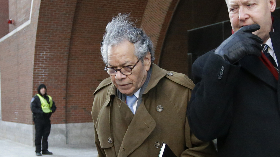 Insys Therapeutics founder John Kapoor (center) departs federal court in Boston in January. The criminal trial of Kapoor and four other executives from the company wrapped up on Friday. (Steven Senne/AP)