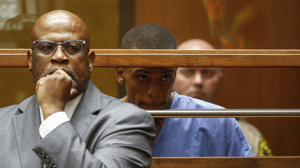 Eric Ronald Holder Jr. (right), 29, who is accused of killing of rapper Nipsey Hussle, appears for arraignment, alongside his Attorney Christopher Darden, left, on April 4, 2019 in Los Angeles.