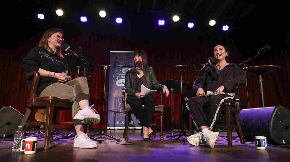 Host Ophira Eisenberg chats with Lesyle Headland and Greta Lee on Ask Me Another at the Bell House in Brooklyn, New York.