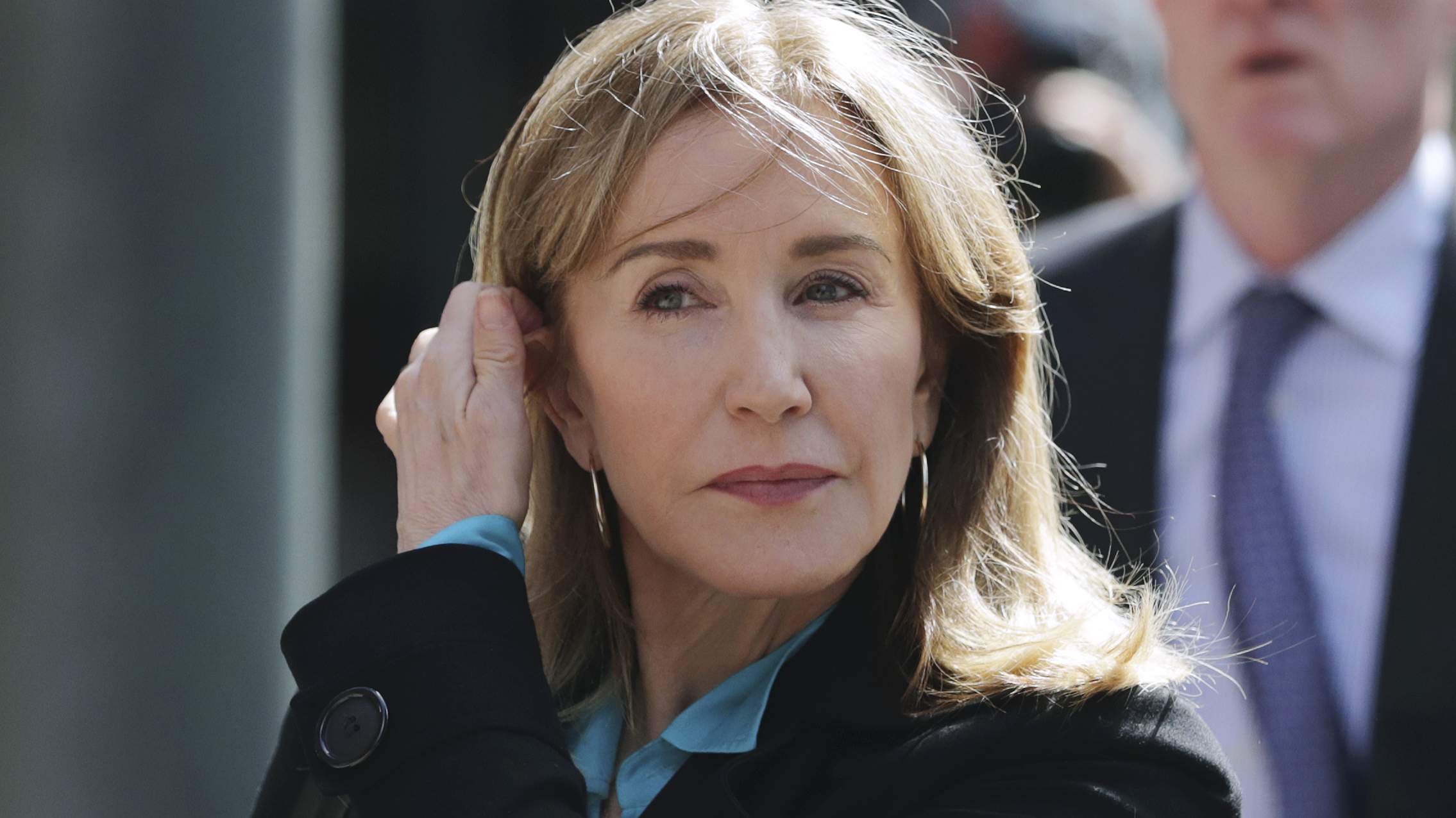 Federal prosecutors say that one coach and 13 parents, including actress Felicity Huffman, will plead guilty to fraud charges in the college admissions scandal. Huffman is seen here arriving  at federal court in Boston last week.