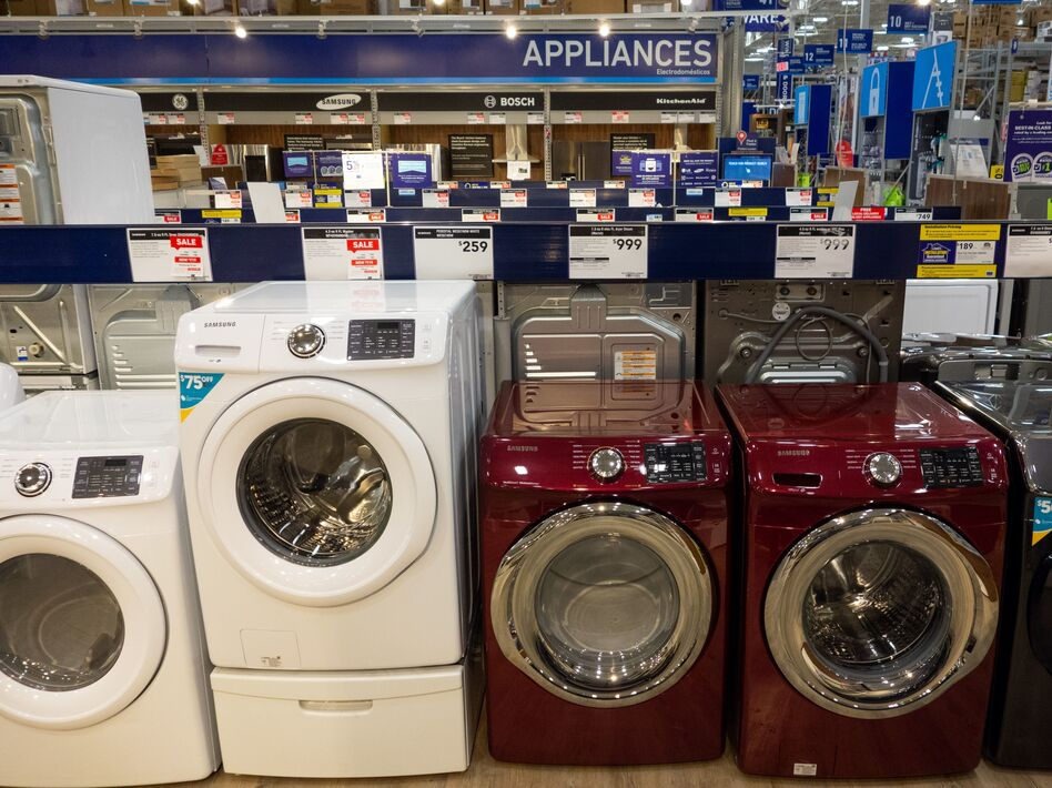 Overall, prices of major appliances tracked by the consumer price index are starting to tick down month-to-month. But they are still higher than they were last year. Washing machines, dryers and other appliances are seen for sale at a Lowe's home improvement store in Washington, D.C., in 2018. (Saul Loeb/AFP/Getty Images)