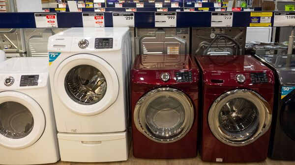Overall, prices of major appliances tracked by the consumer price index are starting to tick down month-to-month. But they are still higher than they were last year. Washing machines, dryers and other appliances are seen for sale at a Lowe