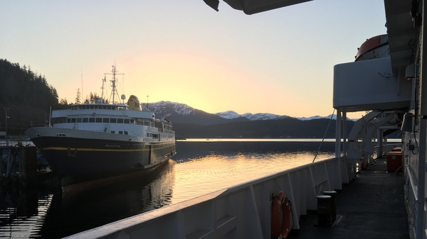 The ferries Malaspina and LeConte are docked near Juneau at sunrise. Both ships are part of Alaska