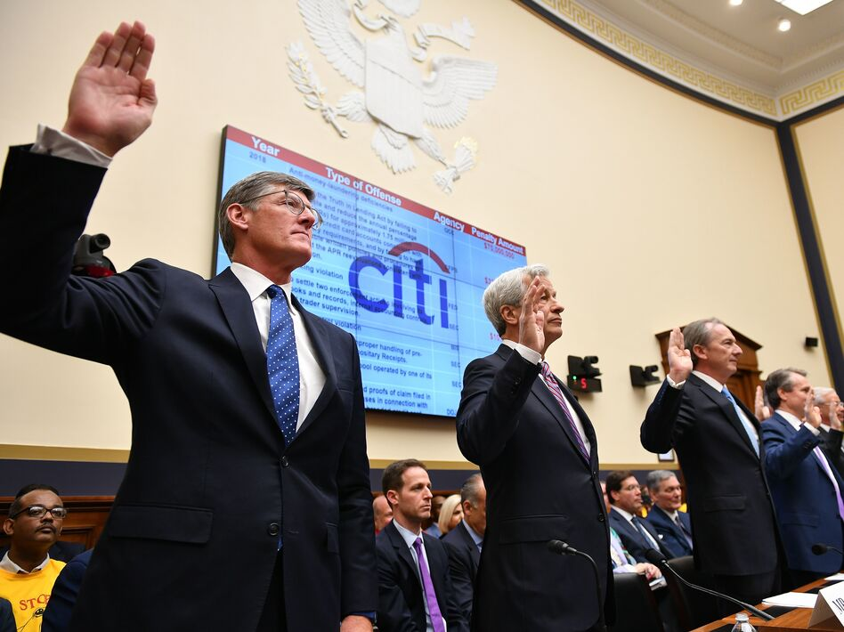 Citigroup Chief Executive Officer Michael Corbat (from left), JPMorgan Chase CEO Jamie Dimon and other top bank executives are sworn in before testifying before the House Financial Services Committee on Wednesday. (Mandel Ngan/AFP/Getty Images)