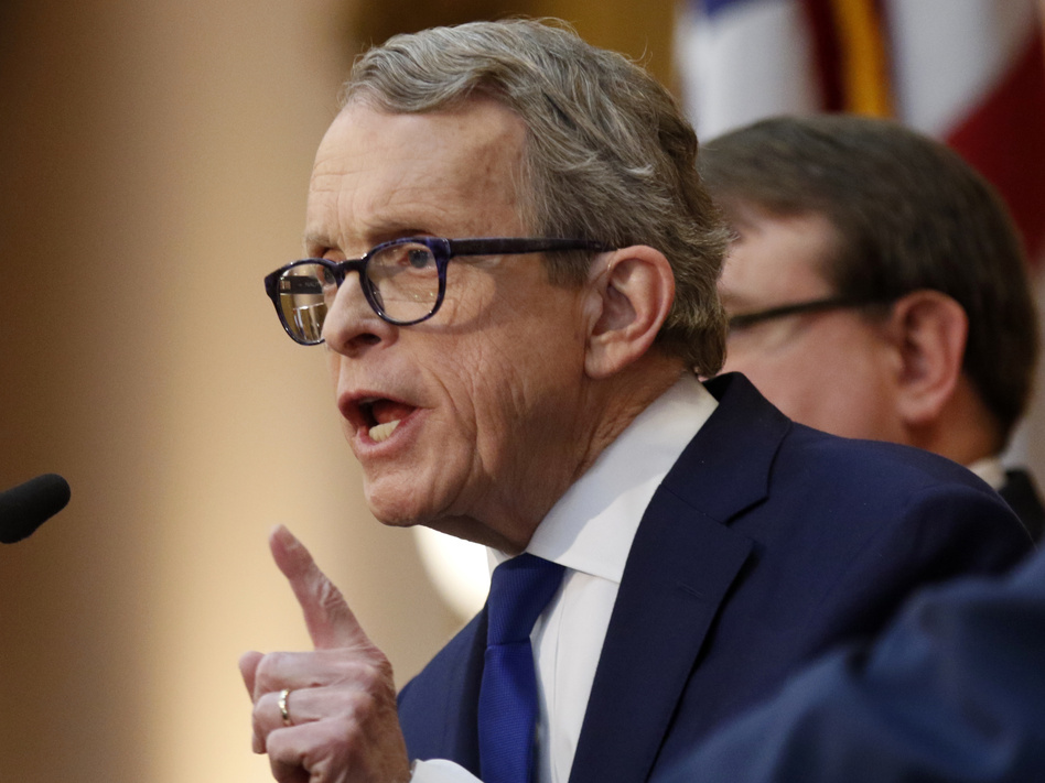 """Ohio Gov. Mike DeWine signed the """"heartbeat bill"""" one day after it passed the Republican-led General Assembly. (Paul Vernon/AP)"""