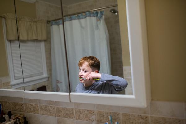 Joseph brushes his teeth before bedtime.