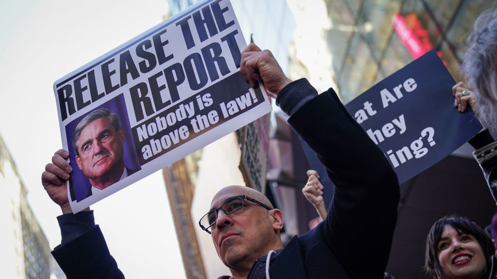 Activists participate in a Release the Report rally in Times Square on April 4 in New York City.