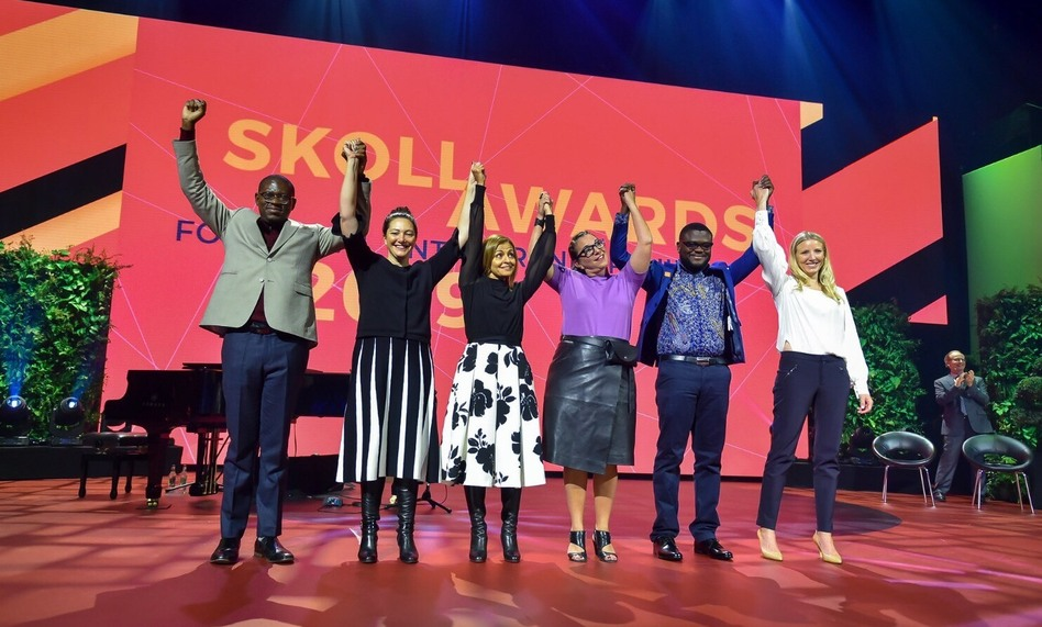Trying to make the world a better place: (left to right) Skoll Award winners Gregory Rockson of mPharma, Nicola Galombik and Maryana Iskander of Harambee Youth Employment Accelerator, Nancy Lublin of Crisis Text Line, Bright Simons of mPedigree and Julie Cordua of Thorn. (Greg Smolonski/Skoll)