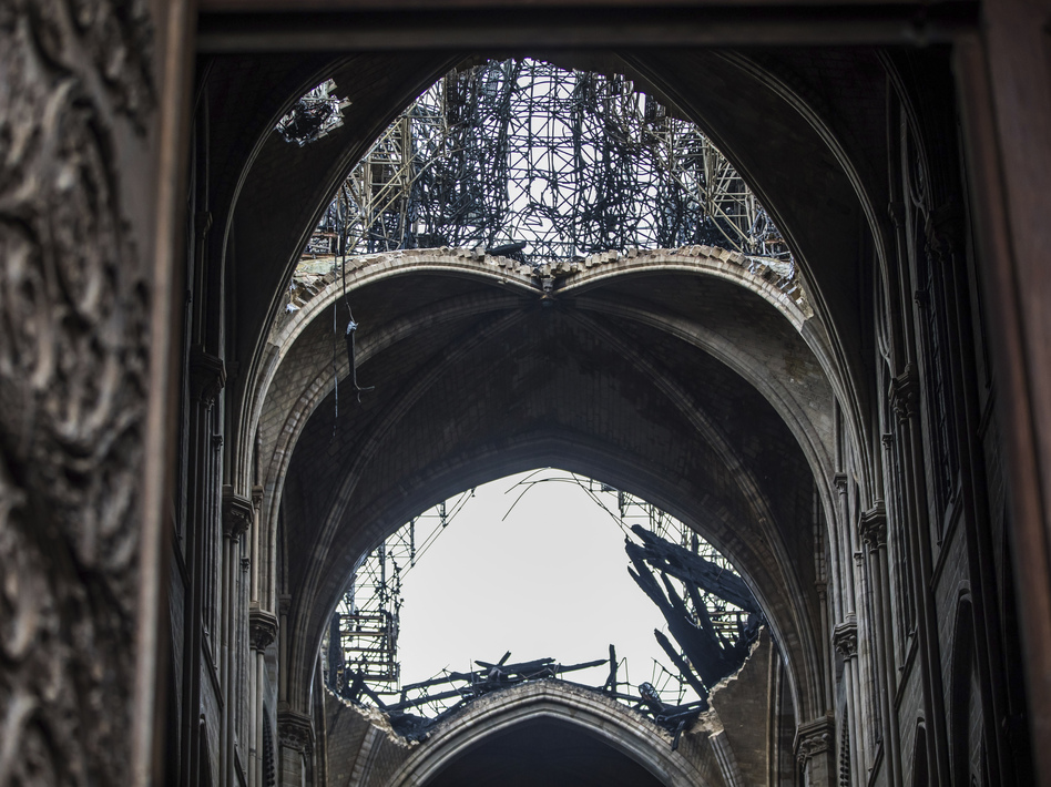 Damage seen from inside Notre Dame Cathedral in Paris on Tuesday. President Emmanuel Macron has set a five-year goal to rebuild the cathedral after Monday's blaze. (Christophe Petit Tesson/AP)