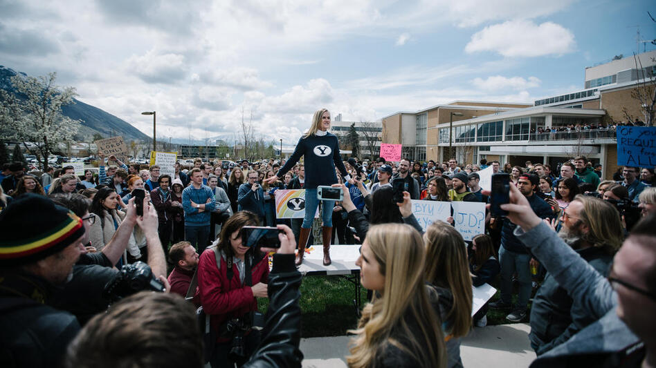 Brigham Young University alumna Sidney Draughon (center) flew in from New York to join a protest against the Honor Code Office. (Kelsie Moore/KUER)