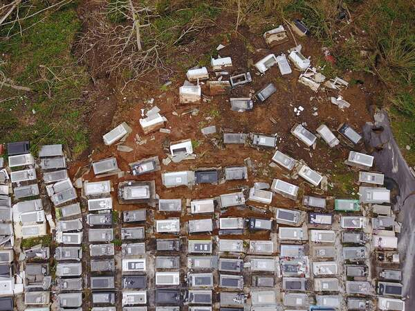 A landslide triggered by extreme rain during Hurricane Maria in 2017 washed coffins downhill from the Lares Municipal Cemetery in Puerto Rico.