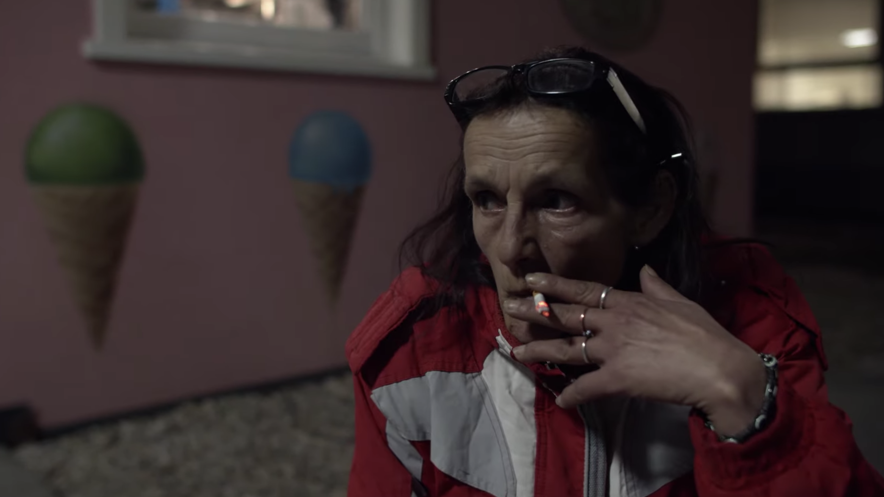 8241a08b55af A woman smokes a cigarette in a scene from Cate Le Bon s video for the song