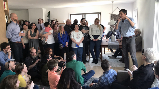 Former Texas Rep. Beto O'Rourke campaigns in a living room on the south side of Des Moines, Iowa. He held six house parties in one day on April 6. (Clay Masters/Iowa Public Radio)