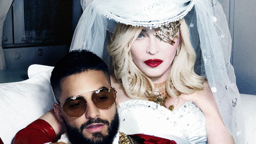 Westlake Legal Group madonna-and-maluma-press-shot_wide-85e3601a4329f3224e59d4d6907a7c32fb0dfe3b Madonna's New Single, 'Medellin,' Is A Self-Aware Nostalgia Trip