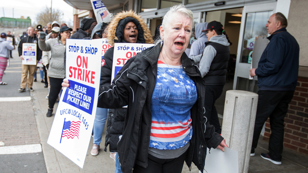 Union members picket a Stop & Shop in Dorchester, Mass.,  prior to the arrival of former Vice President Joe Biden on Thursday.