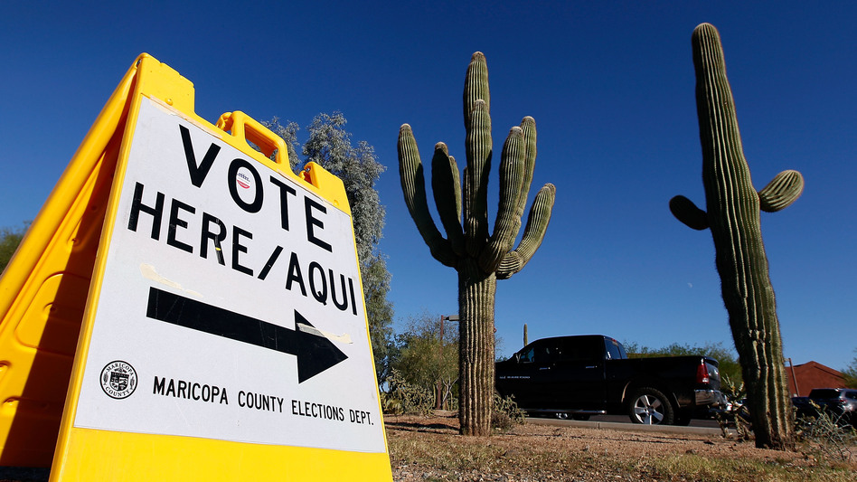 A sign directs voters to a polling station on Nov. 8, 2016, in Cave Creek, Arizona. The state is one of several considering new voting laws that could make it more complicated to vote in 2020. (Ralph Freso/Getty Images)