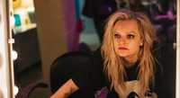 """Elisabeth Moss plays Becky Something, a punk singer struggling with substance abuse, in the new film <em>Her Smell. </em>""""It was the hardest dialogue I've ever had to learn,"""" she says."""