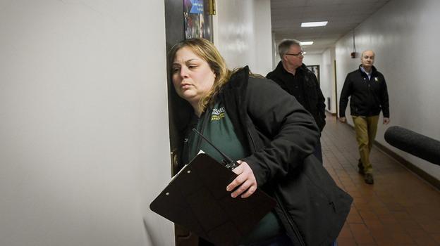 Jaclyn Schildkraut, associate professor of Criminal Justice at SUNY Oswego, leads a lockdown drill at Ed Smith Elementary School in Syracuse, N.Y., last month. (Heather Ainsworth/Colorado Public Radio)