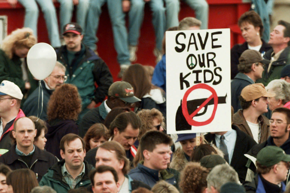 On April 25, 1999, a memorial service honors the victims of the Columbine High School shooting in Littleton, Colo. (Eric Gay/AP)