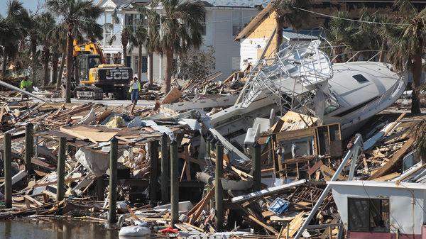 Debris from Hurricane Michael rests along a canal on Oct. 18, 2018, in Mexico Beach, Fla. NOAA upgraded the storm to a Category 5 after completing its analysis.
