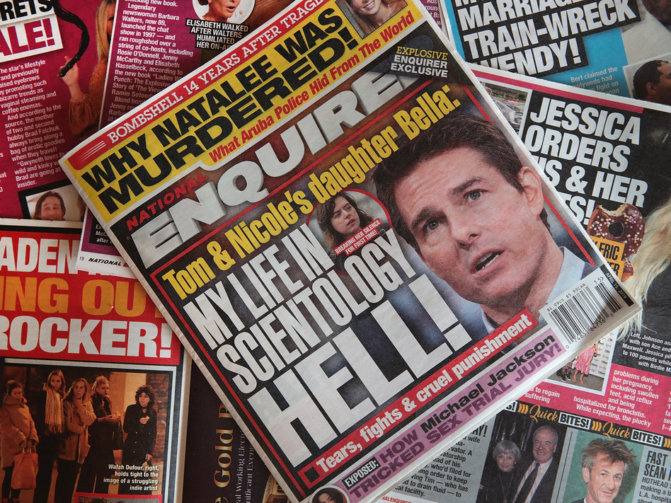 American Media Inc., parent company of the <em>National Enquirer</em>, struck a deal to sell the tabloid and two other publications. (Scott Olson/Getty Images)