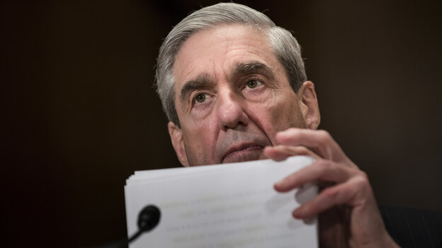Robert Mueller testifies before Congress in 2013. A redacted version of Mueller's report as special counsel was released on Thursday. (Brendan Smialowski/AFP/Getty Images)