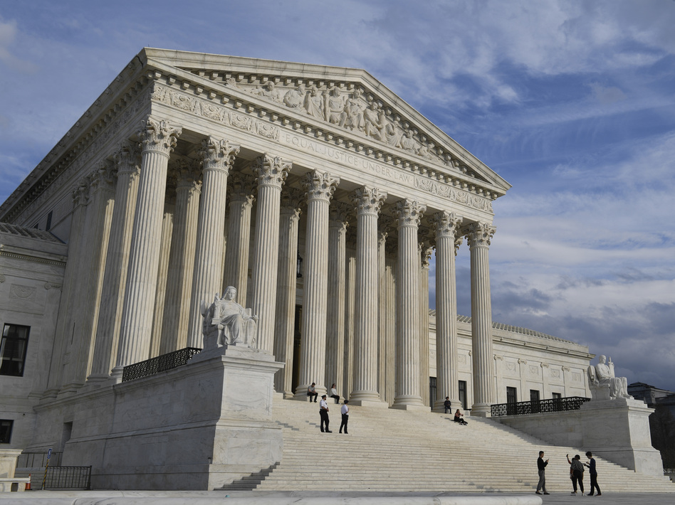 The Supreme Court justices are hearing oral arguments Tuesday over the citizenship question the Trump administration wants to add to forms for the 2020 census. (Susan Walsh/AP)