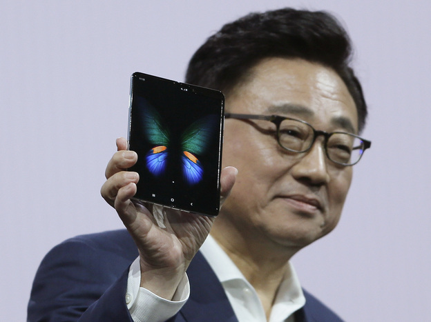 Samsung executive DJ Koh holds up the new Galaxy Fold smartphone during an event on Feb. 20 in San Francisco. On Monday, the company announced it is delaying the device's launch. (Eric Risberg/AP)