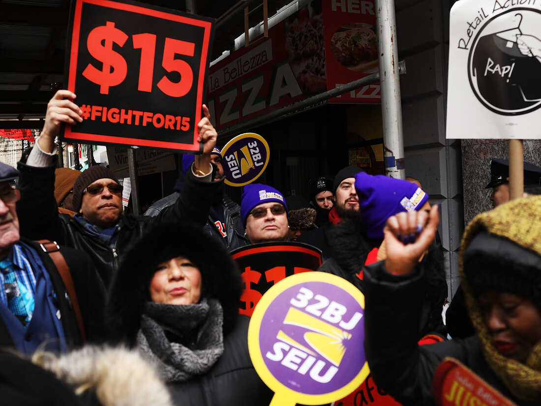 Protesters with NYC Fight for $15 gather in front of a McDonalds.