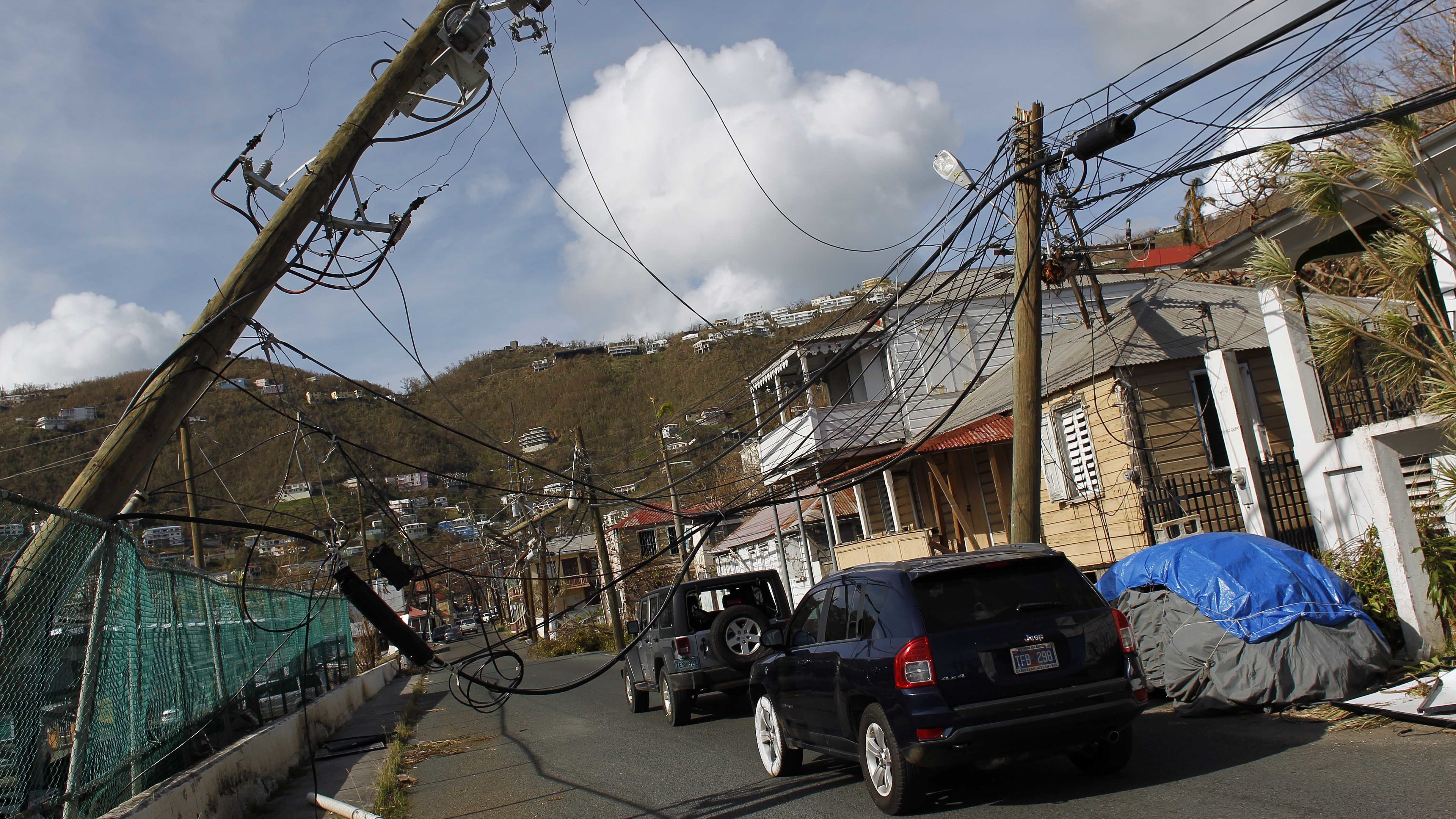 Damaged power lines hang over a street after Hurricane Irma hit the U.S. Virgin Islands on Sept. 6, 2017. That same month, another Category 5 hurricane hit the U.S. territory.
