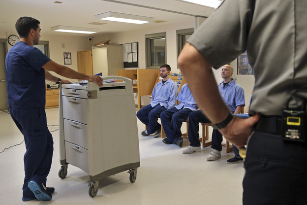 In Massachusetts last July, several Franklin County Jail inmates were watched by a nurse and a corrections officer after receiving their daily doses of buprenorphine, a drug that helps control opioid cravings. By some estimates, at least half to two-thirds of today's U.S. jail population has a substance use or dependence problem. (Elise Amendola/AP)