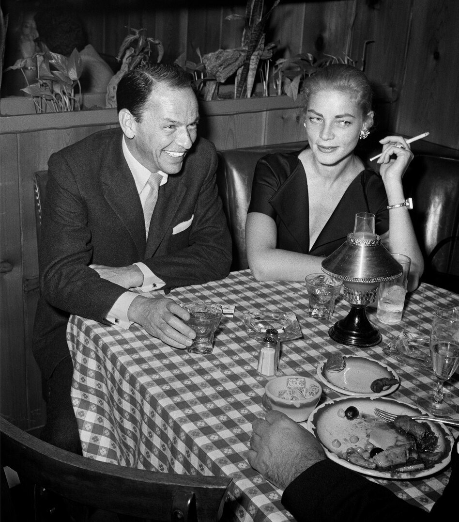 Frank Sinatra and Lauren Bacall have a drink at Musso & Frank Grill in 1957. (Frank Worth, Courtesy of Capital Art/Getty Images)