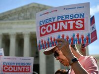 Demonstrators gathered outside the Supreme Court Tuesday to protest the Trump administration's proposal to add a citizenship question to the 2020 Census.