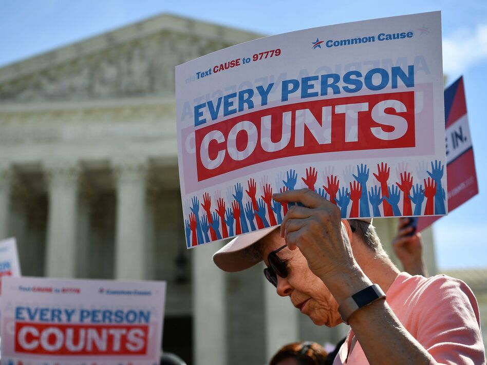 Demonstrators gathered outside the Supreme Court Tuesday to protest the Trump administration's proposal to add a citizenship question to the 2020 Census. (Mandel Ngan/AFP/Getty Images)