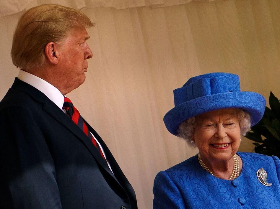 President Trump has accepted an invitation for a state visit from Britain's Queen Elizabeth II, setting up a trip in early June. The two are seen here during Trump's visit to the U.K. last June. (Brendan Smialowski/AFP/Getty Images)