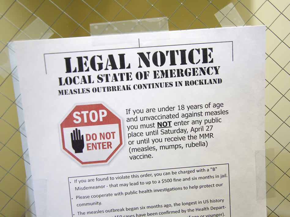A sign at the Rockland County Health Department in Pomona, N.Y., explains the local state of emergency caused by a measles outbreak. (Seth Wenig/AP)