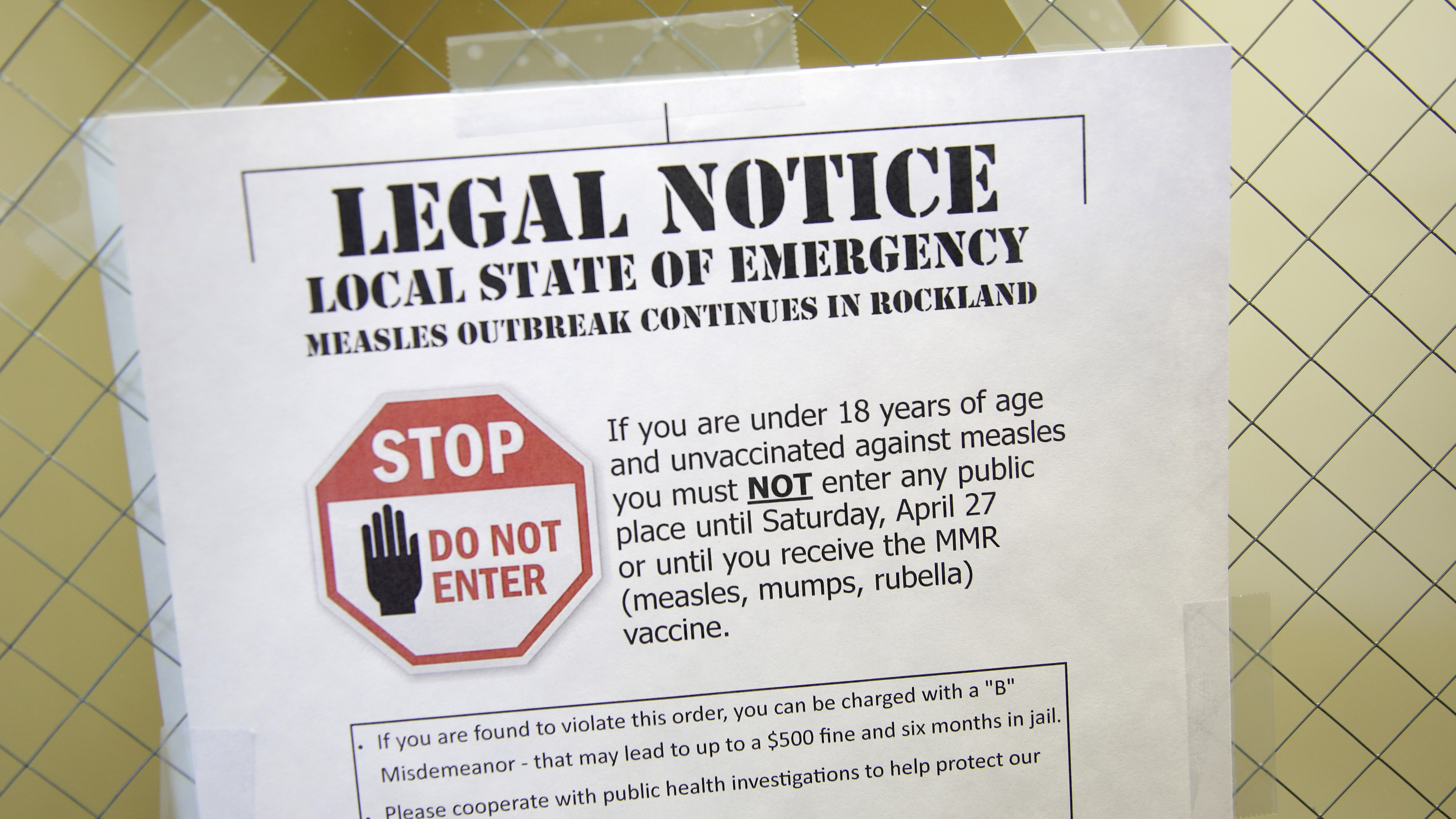 A sign at the Rockland County Health Department in Pomona, N.Y., explains the local state of emergency caused by a measles outbreak.