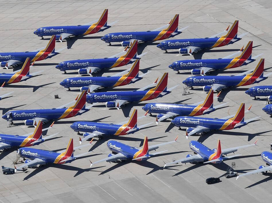 Southwest Airlines Boeing 737 Max aircraft are parked on the tarmac after being grounded, at the Southern California Logistics Airport in Victorville, Calif., on March 28. Boeing said its financial outlook is uncertain as it deals with the 737 Max grounding. (Mark Ralston/AFP/Getty Images)
