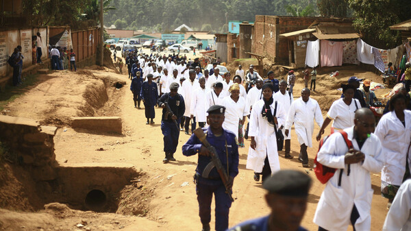 Health workers marched in Butembo on Wednesday to protest the violence they