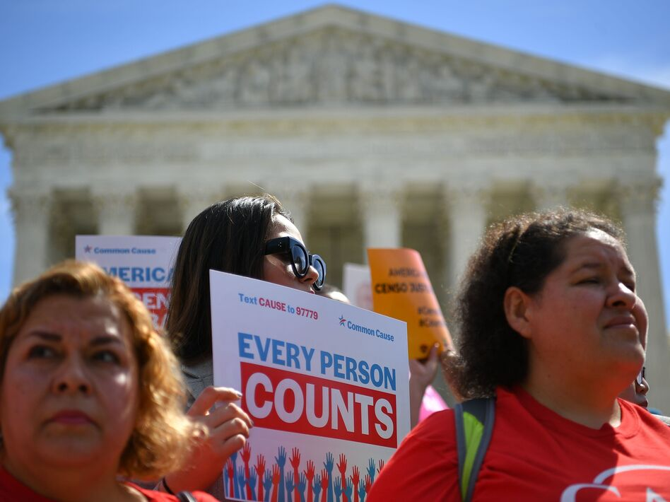Demonstrators rally outside the U.S. Supreme Court in April to protest against the Trump administration's efforts to add a citizenship question to the 2020 census. (Mandel Ngan/AFP/Getty Images)