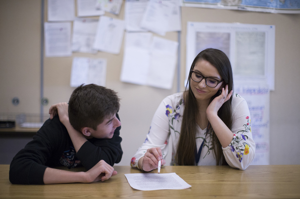 Libsack works with student Kellen Filker, 14, during a recent lesson on structuring the essay. Under rules changes, Libsack should now have five more years to complete her final year of service. She'll still need to change schools to qualify, but it will mean she won't have to pay upward of $20,000 in loans.
