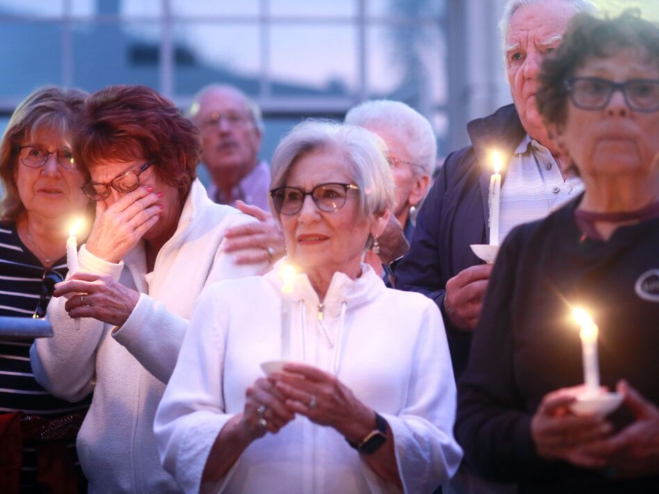 Mourners participate in a candle light vigil for the victims of the Chabad of Poway Synagogue shooting at the Rancho Bernardo Community Presbyterian Church on April 27, 2019 in Poway, Calif. (Sandy Huffaker/AFP/Getty Images)