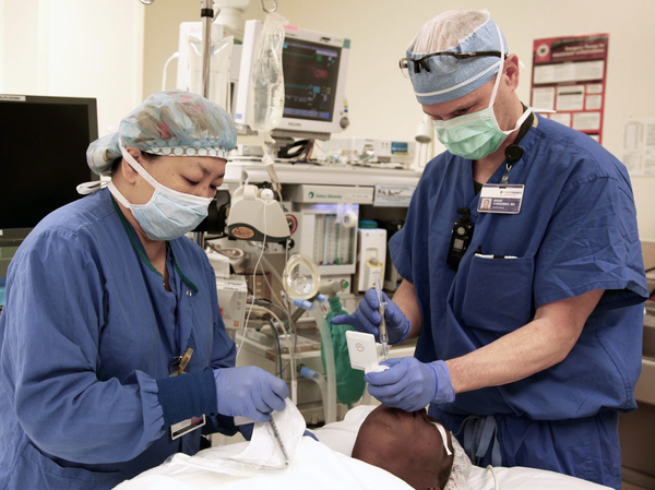 Dr. Brian Chesebro (right), in Portland, Ore., has calculated that by simply using the anesthesia gas sevoflurane in most surgeries, instead of the similar gas desflurane, he can significantly cut the amount of global warming each procedure contributes to the environment.
