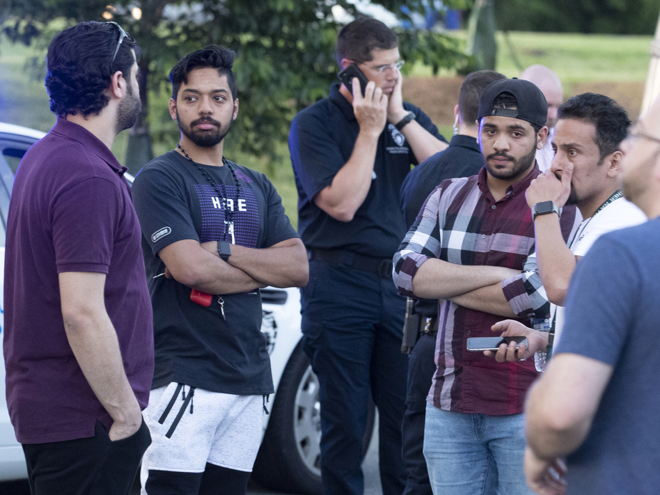People gather across from the campus of the University of North Carolina, Charlotte after a shooting at the school on Tuesday. (Jason E. Miczek/AP)