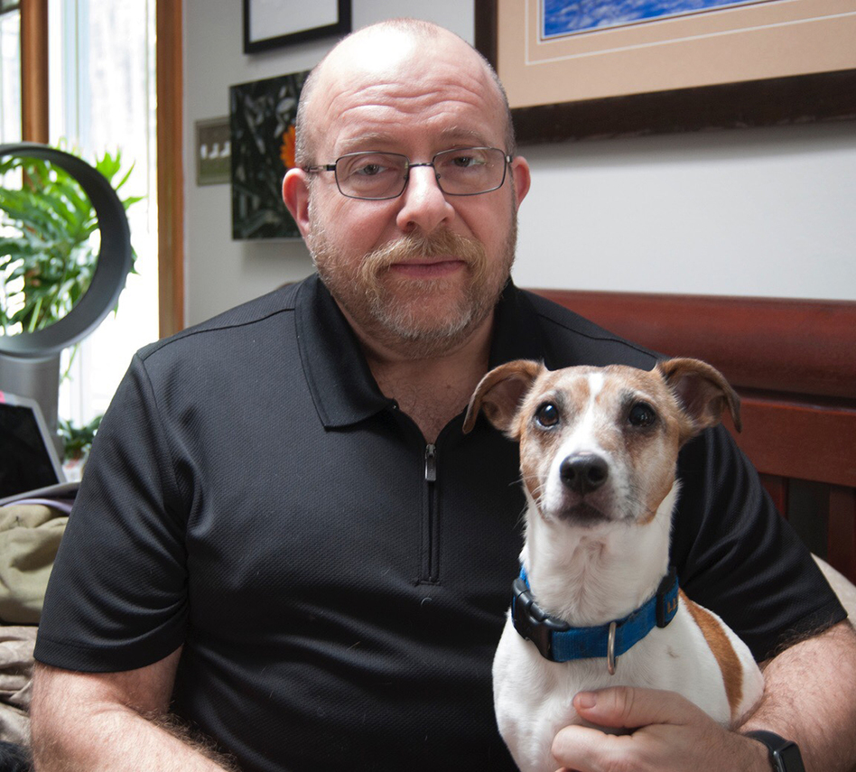 Phil Gutis with his dog, Abe, who died last year. Gutis, who has Alzheimer's, hoped an experimental drug could help preserve his memories. (Courtesy of Timothy Weaver)