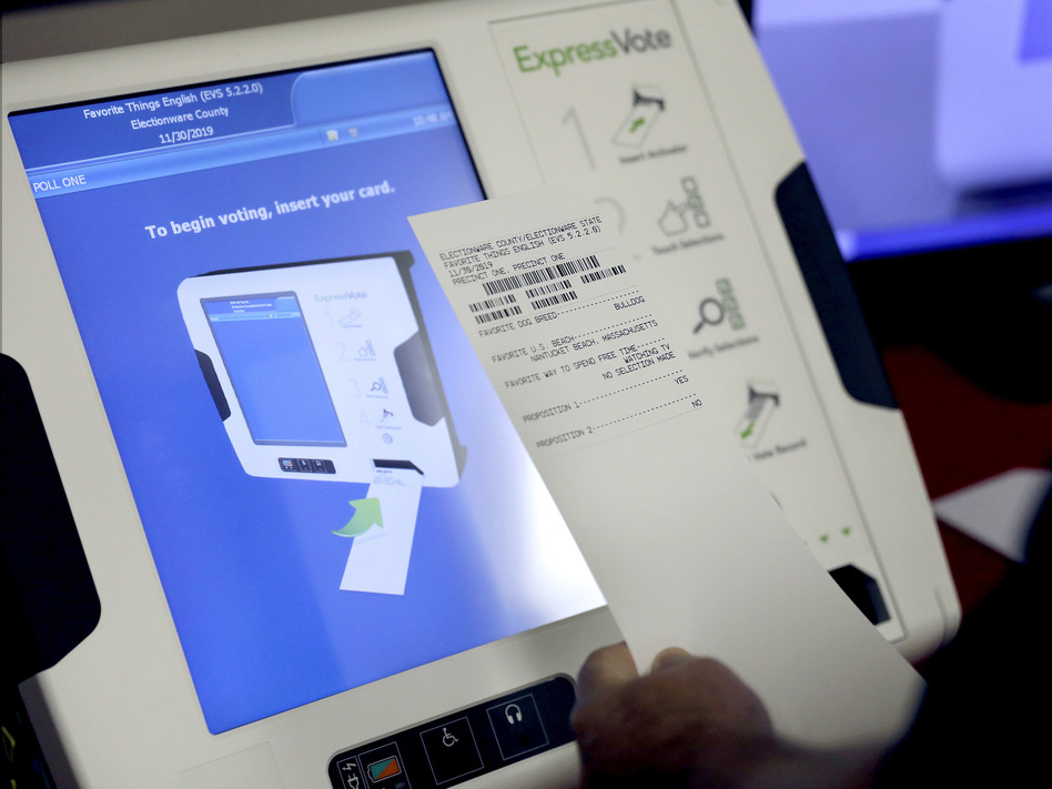 An electronic voting machines that produces a paper receipt from Election Services & Software. The company is among those bidding to replace all of Georgia's voting machines but close relationships between state officials and ES&S have raised questions about the fairness of the bidding process. (David Goldman/AP)
